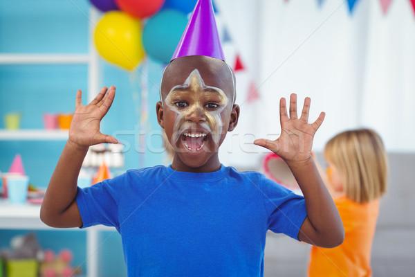 Mosolyog fiú arc festett születésnapi buli buli Stock fotó © wavebreak_media