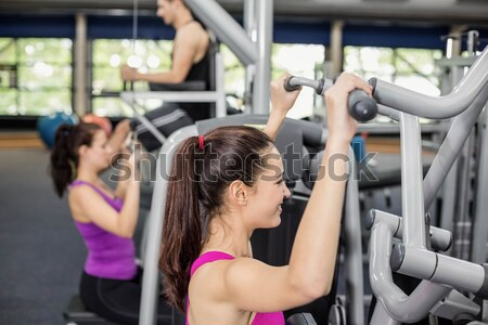 Male trainer assisting woman lifting dumbbells Stock photo © wavebreak_media