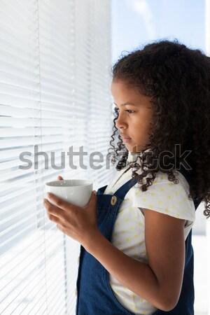 Kadın dizüstü bilgisayar kullanıyorsanız kahve ev iş sevmek Stok fotoğraf © wavebreak_media