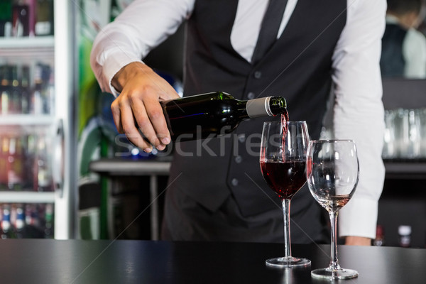 Mid section of bartender pouring red wine in a glass Stock photo © wavebreak_media
