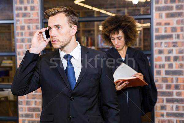 ビジネスマン 話し スマートフォン 弁護士 読む 法 ストックフォト © wavebreak_media