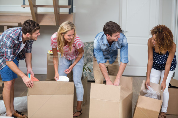 Friends unpacking carton in new house Stock photo © wavebreak_media