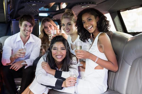 Happy friends drinking champagne Stock photo © wavebreak_media