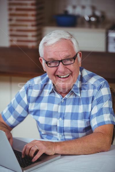 Portre mutlu emekli adam dizüstü bilgisayar kullanıyorsanız ev Stok fotoğraf © wavebreak_media