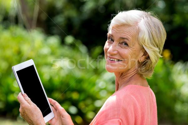 Senior woman with tablet at yard  Stock photo © wavebreak_media
