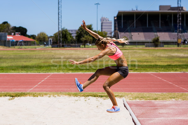 Female athlete performing a long jump Stock photo © wavebreak_media