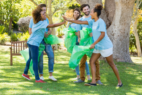 Group of volunteer having fun while collecting rubbish Stock photo © wavebreak_media
