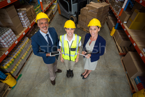 High angle view of managers and worker wearing hard hat and look Stock photo © wavebreak_media