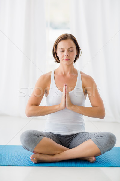 Full length of young woman doing yoga Stock photo © wavebreak_media