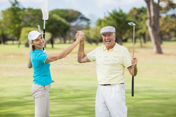 портрет гольфист пару high five Постоянный области Сток-фото © wavebreak_media
