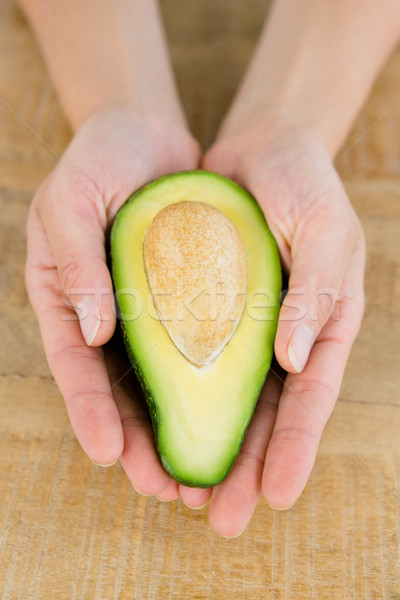 Person holding avocado at table Stock photo © wavebreak_media