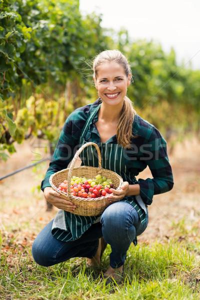 Happy vintner holding a basket of grapes Stock photo © wavebreak_media