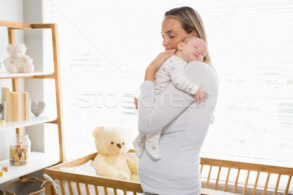 Mother holding and embracing her baby boy Stock photo © wavebreak_media