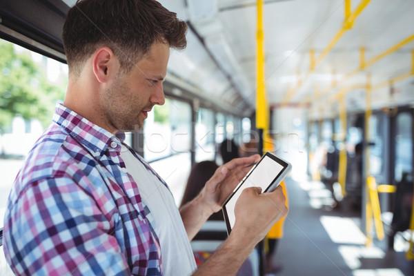 Yakışıklı adam dijital tablet otobüs sevmek adam Stok fotoğraf © wavebreak_media