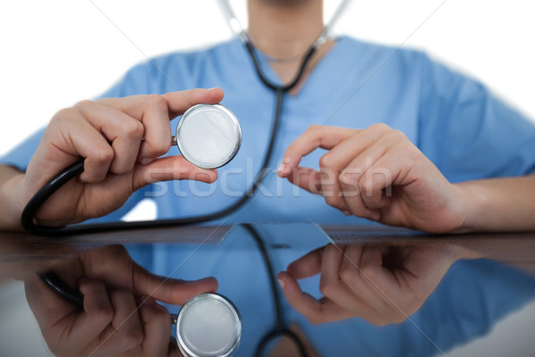 Mid-section of female doctor examining digital tablet with a stethoscope Stock photo © wavebreak_media