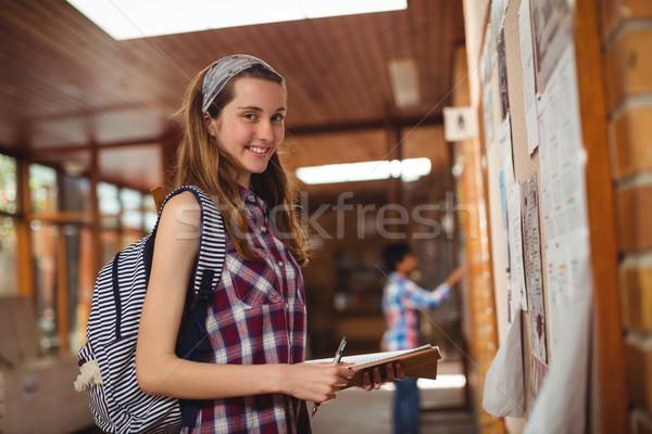 портрет улыбаясь школьница Постоянный книга Сток-фото © wavebreak_media