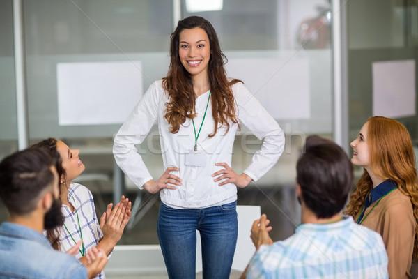 Executives appreciating their colleague during presentation Stock photo © wavebreak_media