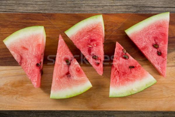 Slices of watermelon arranged on chopping board Stock photo © wavebreak_media