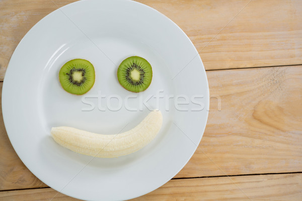 Banana fetta kiwi piatto legno viaggio Foto d'archivio © wavebreak_media