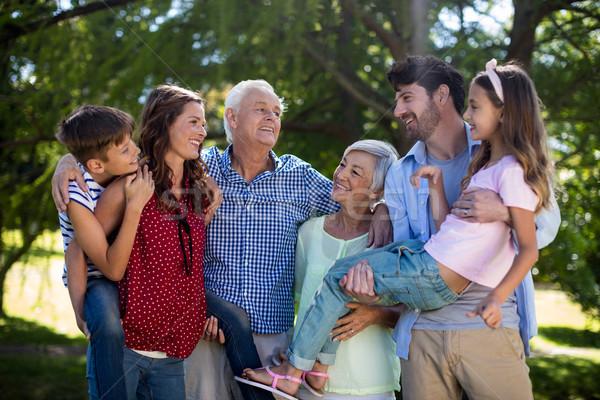Smiling family posing together in park Stock photo © wavebreak_media