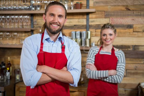 Glimlachend mannelijke barista vrouwelijke collega coffeeshop Stockfoto © wavebreak_media