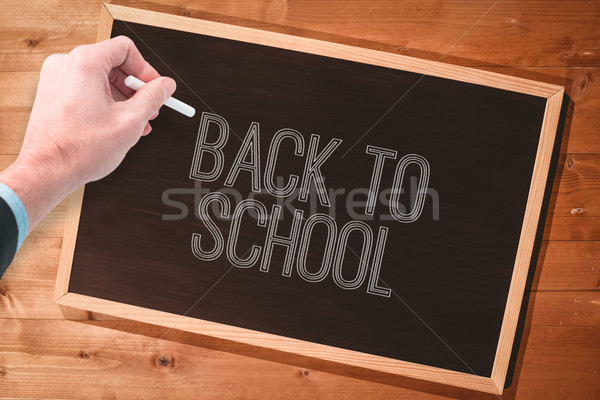 Composite image of hand writing with a white chalk Stock photo © wavebreak_media