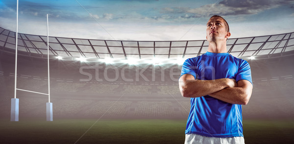 Composite image of serious rugby player looking away with arms crossed Stock photo © wavebreak_media