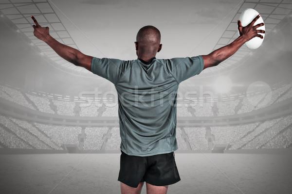 összetett kép hátsó nézet atléta karok a magasban tart Stock fotó © wavebreak_media
