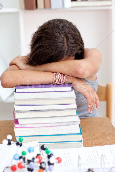 Tired teeenager sleeping on books Stock photo © wavebreak_media