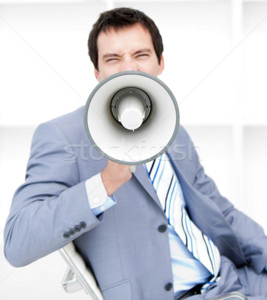 Furious young businessman yelling through a megaphone Stock photo © wavebreak_media