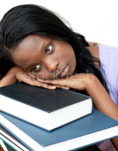 Annoyed student leaning on a stack of books  Stock photo © wavebreak_media