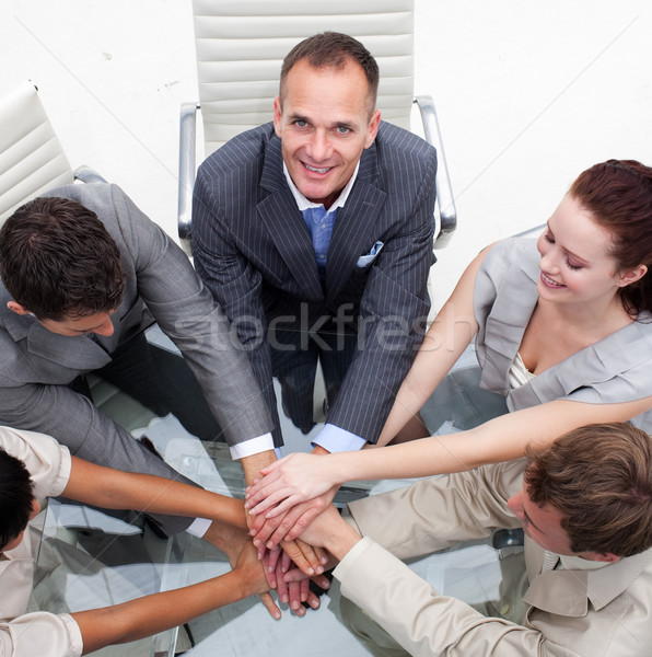 Close-up of multi-ethnic business team with hands together Stock photo © wavebreak_media