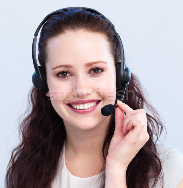 Portrait of smiling beautiful woman with a headset on Stock photo © wavebreak_media