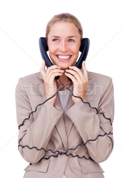 Bájos üzletasszony felfelé telefon drótok fehér Stock fotó © wavebreak_media