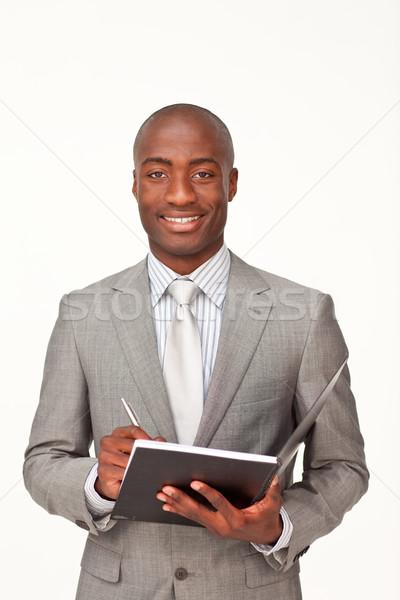 üzletember ír jegyzetek fehér könyv toll Stock fotó © wavebreak_media