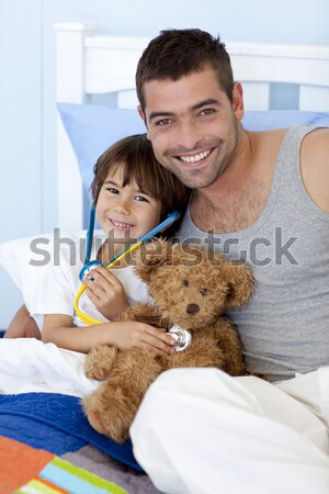 Smiling little boy attending a medical check-up Stock photo © wavebreak_media
