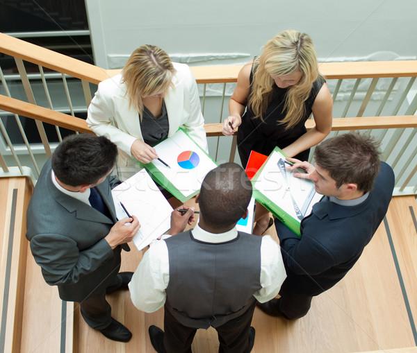 бизнес-команды заседание лестницы молодые служба бумаги Сток-фото © wavebreak_media
