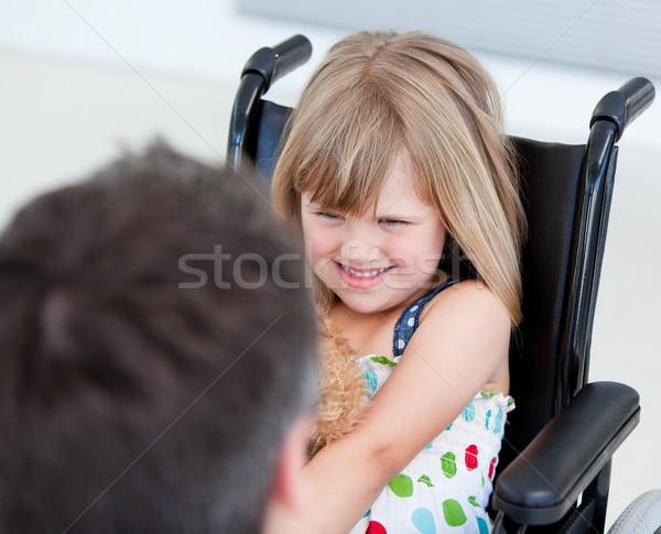 Küçük kız oturma tekerlekli sandalye hastane kız çocuklar Stok fotoğraf © wavebreak_media