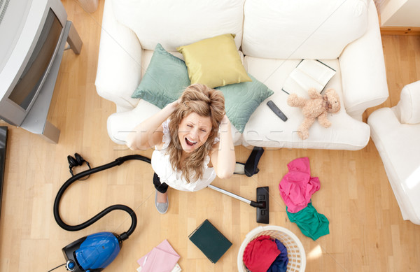 Stressed blond woman vacuuming the living-room Stock photo © wavebreak_media