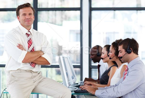 Senior manager with crossed arms in a call center Stock photo © wavebreak_media
