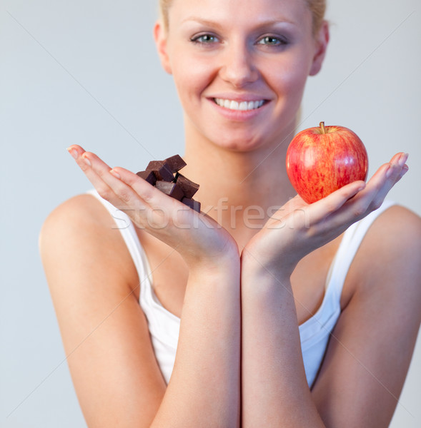 Blonde woman showing chocolate and apple focus on chocolate and apple  Stock photo © wavebreak_media