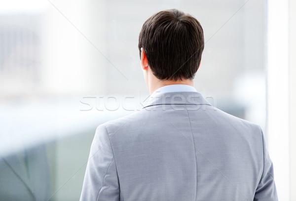üzletember néz ablak épület iroda boldog Stock fotó © wavebreak_media