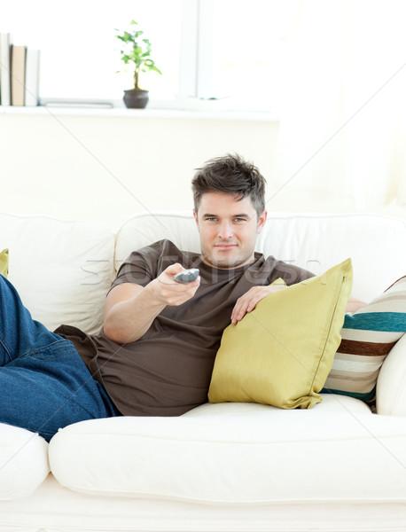 Souriant homme détente living sourire heureux Photo stock © wavebreak_media