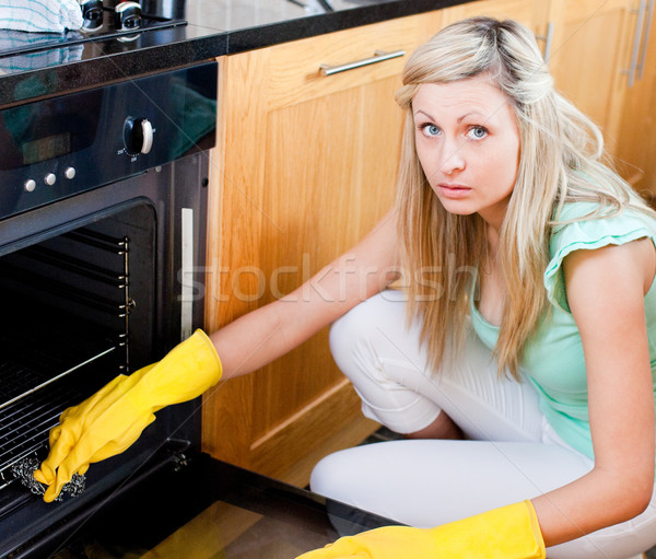 Portrait of a radiant housewife cleaning Stock photo © wavebreak_media
