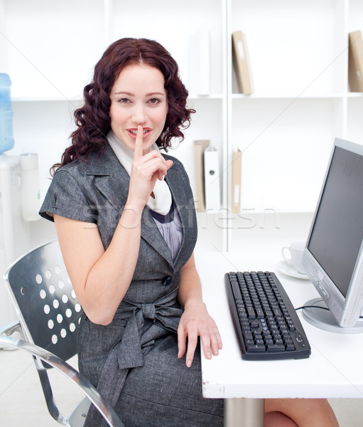 Beautiful young businesswoman demanding silence in office Stock photo © wavebreak_media