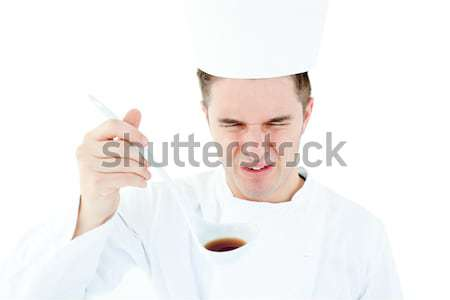 Handsome cook giving hand signal against white background  Stock photo © wavebreak_media