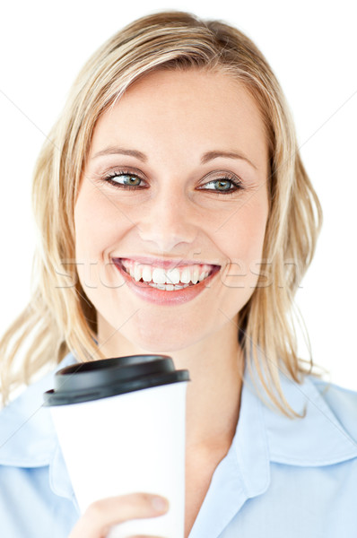 Delighted businesswoman holding a cup of coffee against a white background Stock photo © wavebreak_media