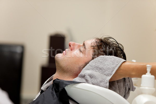 Handsome caucasian man shampooed in a hairdressing salon Stock photo © wavebreak_media