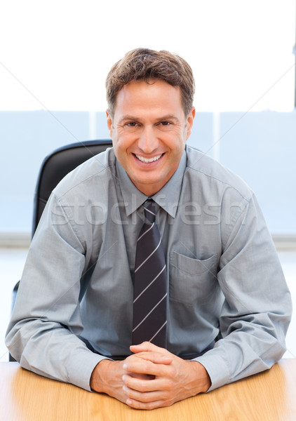 Happy manager sitting at a table Stock photo © wavebreak_media
