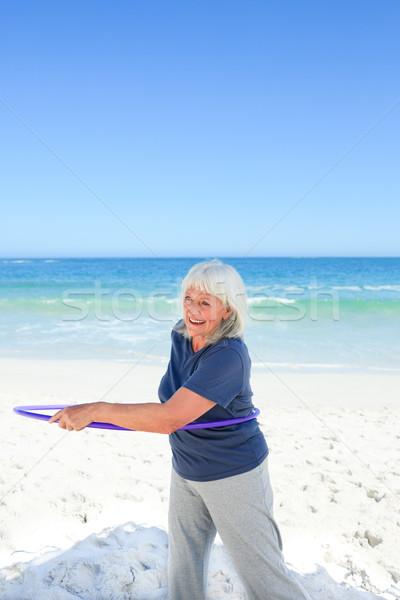 Senior woman playing with her hoop Stock photo © wavebreak_media